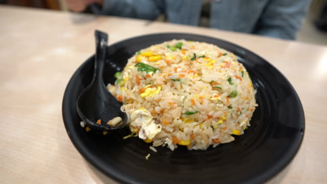 hot and steaming chinese food yangzhou fried rice - jiangsu province stock videos & royalty-free footage