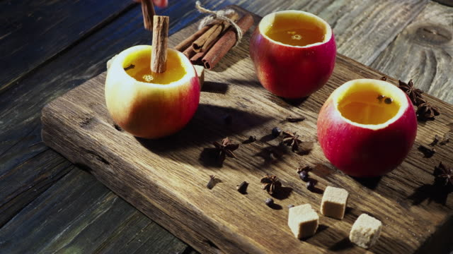 hot apple cider in apple cups - apple fruit stock videos & royalty-free footage