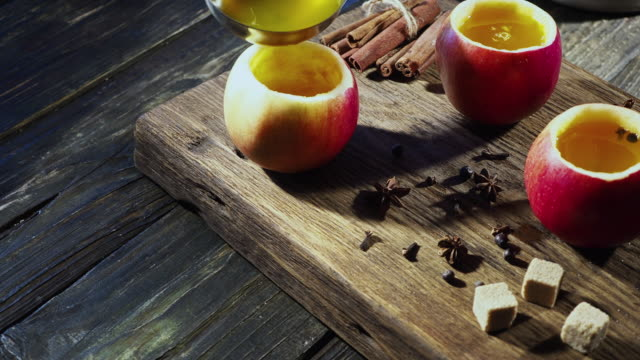 hot apple cider in apple cups - ladle stock videos & royalty-free footage