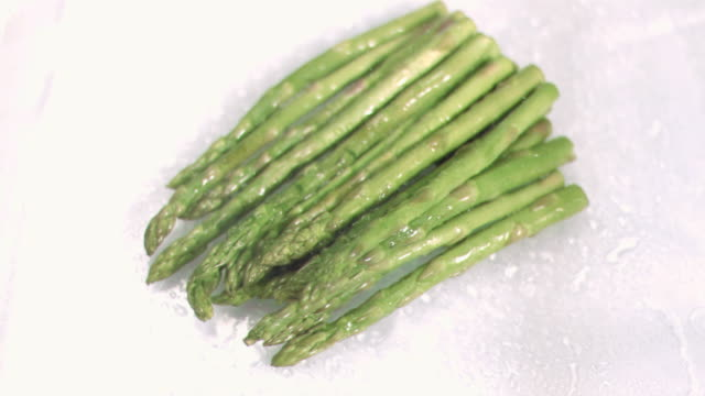 hot asparagus in super slow motion - asparagus stock videos & royalty-free footage