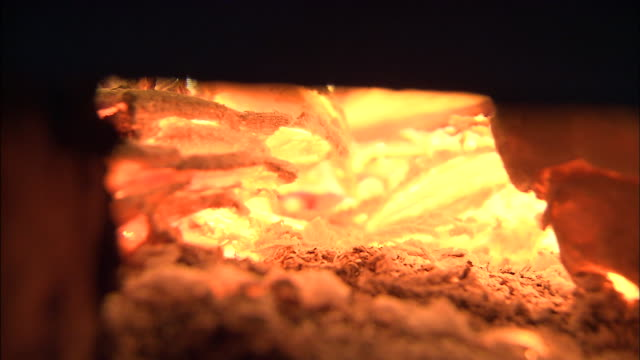 hot bamboo kindling burns in a kiln. - kiln stock videos and b-roll footage