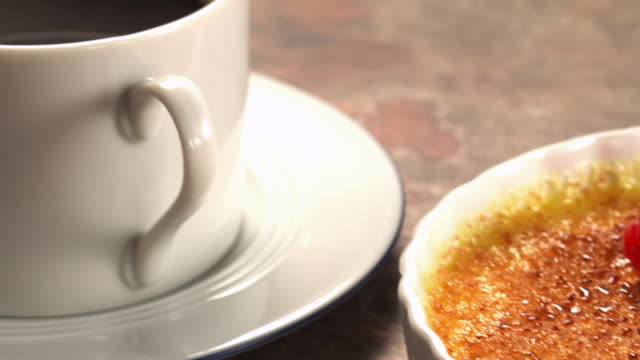 ms pan hot black coffee in white cup and creme brulee in ramekin / los angeles, california, united states - löffel stock-videos und b-roll-filmmaterial