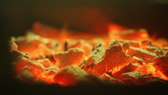 Hot, burning coals close up