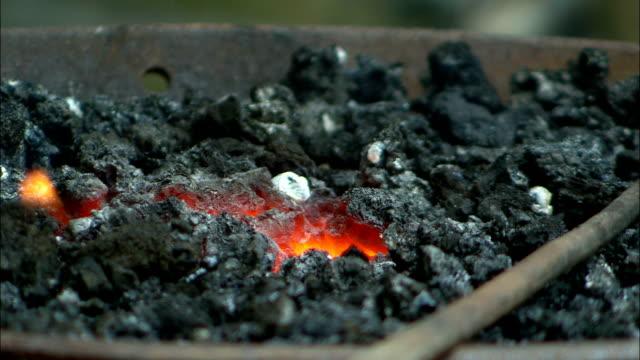 hot coals burn in a bucket. - burning coal stock videos & royalty-free footage