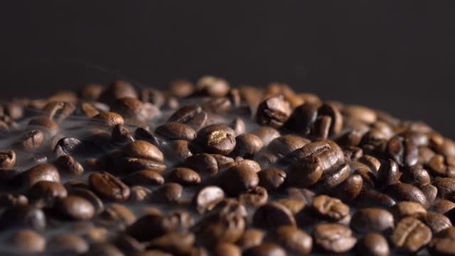 hot coffee beans with smoke - bean stock videos & royalty-free footage