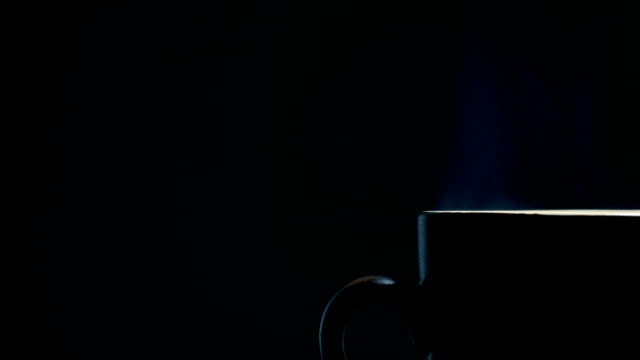 hot coffee cup on black background - steam stock videos & royalty-free footage