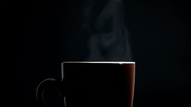 hot coffee cup on black background - tea hot drink stock videos & royalty-free footage