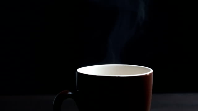Hot coffee cup on black background
