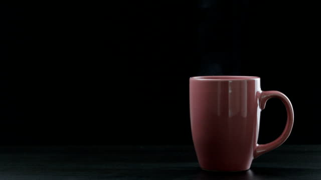 hot coffee cup on black background - tea cup stock videos and b-roll footage