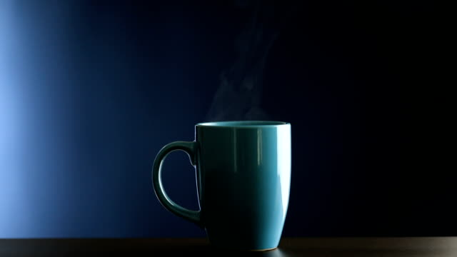 Hot coffee cup on blue background