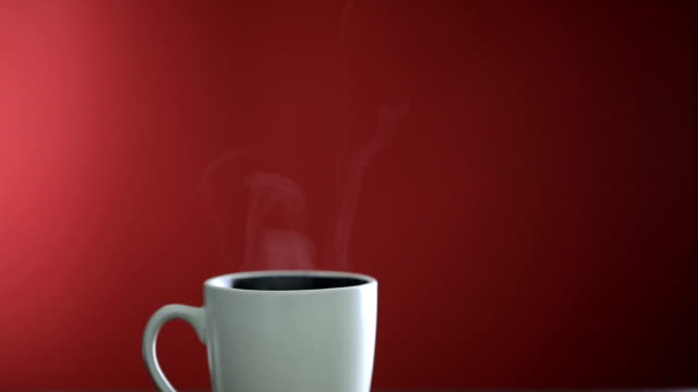 hot coffee cup on red background - steam stock videos & royalty-free footage