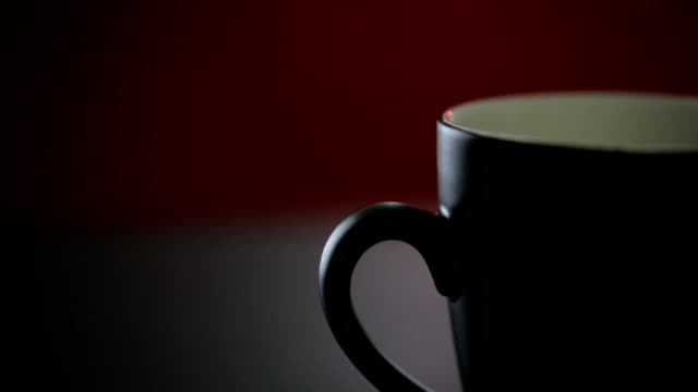 hot coffee cup on red background - coffee cup stock videos & royalty-free footage