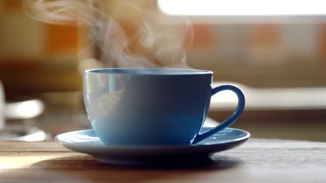 hot coffee cup steaming on table - mug stock videos & royalty-free footage