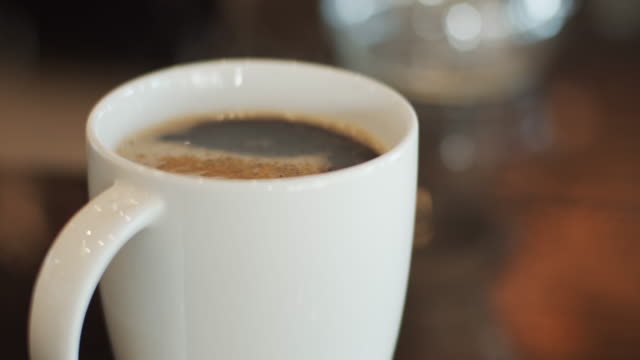 hot coffee on the table at night. - coffee cup stock videos & royalty-free footage