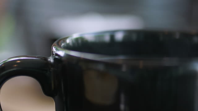 hot coffee steam in black cup - mug stock videos & royalty-free footage
