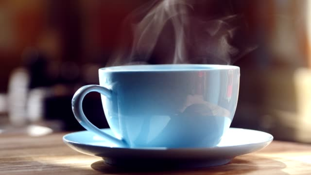 hot coffee with steam on table - coffee table stock videos & royalty-free footage
