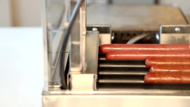 hot dogs on roller grill - concession stand stock videos and b-roll footage