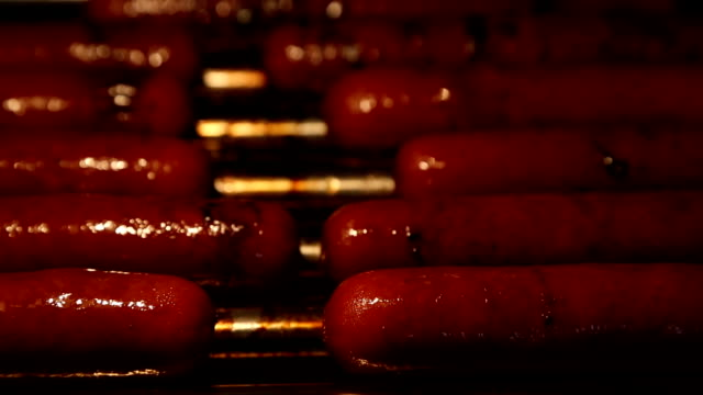 hot dogs on rolling grill - hot dog stock videos & royalty-free footage