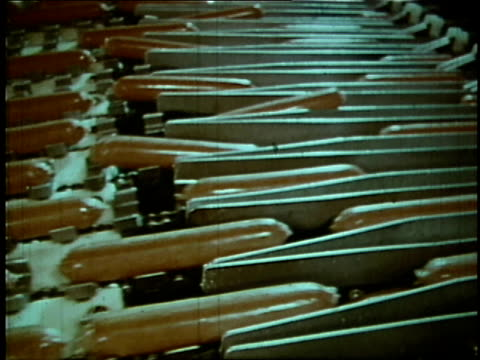 1970 MONTAGE Hot dogs travel down assembly line through an Oscar Mayer facility