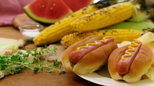 hot dogs with potato chips and roasted corns - hot dog stock videos & royalty-free footage