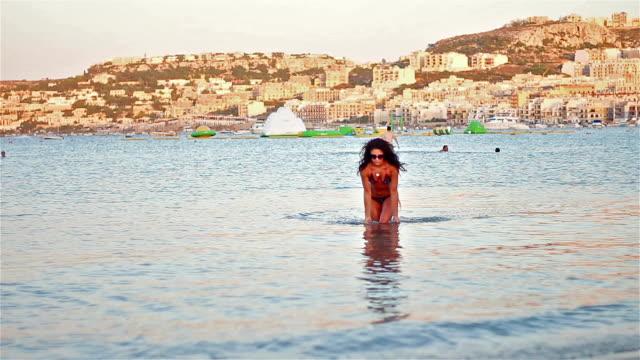 hot girl enjoying the beautiful clear water on malta coast - little girls flashing stock videos and b-roll footage