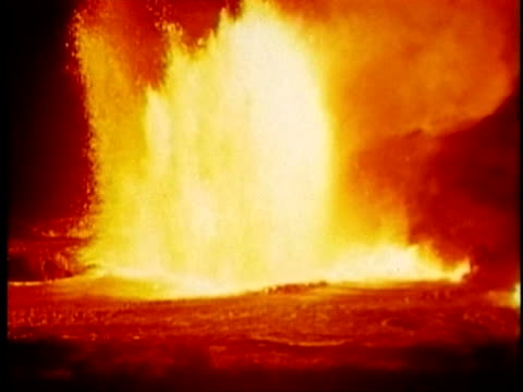 1970 montage ms pan hot lava spraying and bubbling, flowing volcanic river near kilauea volcano / hawaii  - kilauea stock videos & royalty-free footage