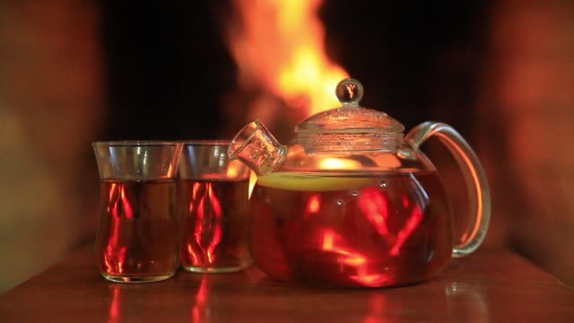 hot lemon tea and two glasses near the fireplace - fireplace stock videos and b-roll footage