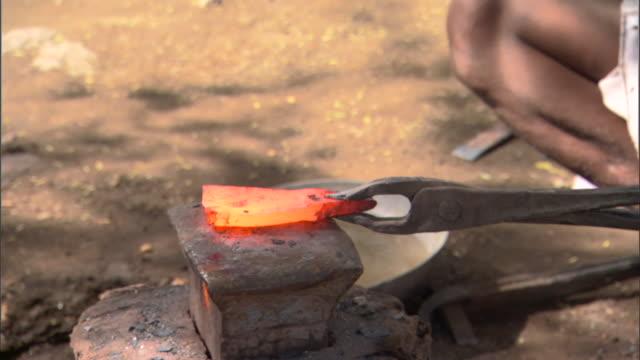 CU Hot metal being hit by blacksmith, Pune, Maharashtra, India
