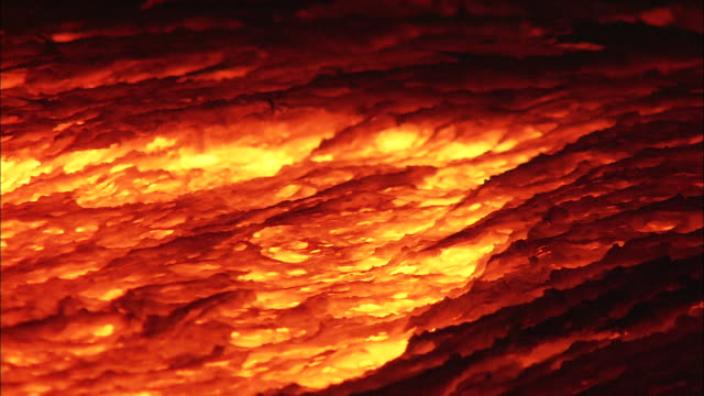 hot molten lava flows down a slope. - geology stock videos & royalty-free footage