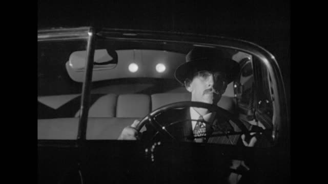 1948 hot on the trail of a killer, the police stake out the residence of a possible victim - film noir style stock videos & royalty-free footage