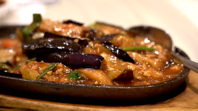 hot pan chinese eggplant - crockery stock videos & royalty-free footage