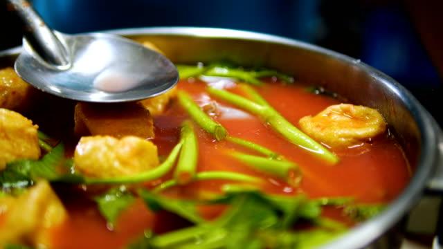 hot pot sukiyaki thai style with pink soup. - thai food stock videos & royalty-free footage