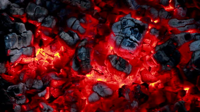 Hot red embers of the campfire