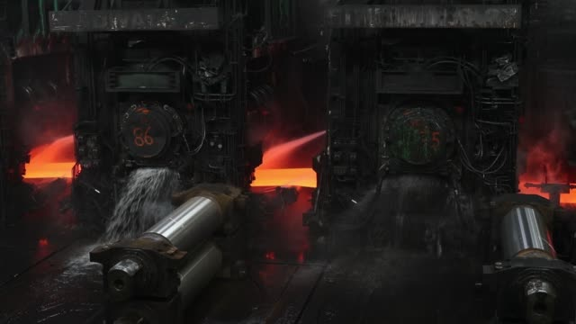Hot rolled steel moves through a mill at the Tata Steel Ijmuiden BV plant a unit of Tata Steel Ltd in Ijmuiden Netherlands on Tuesday Aug 9 2016