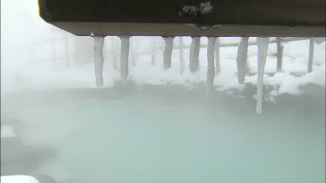 hot spring amid snow - hot spring stock videos & royalty-free footage