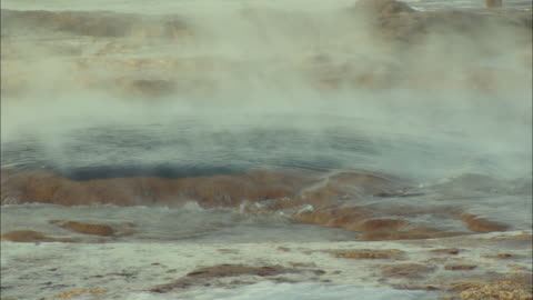 a hot spring bubbles and steams. - geyser stock videos & royalty-free footage