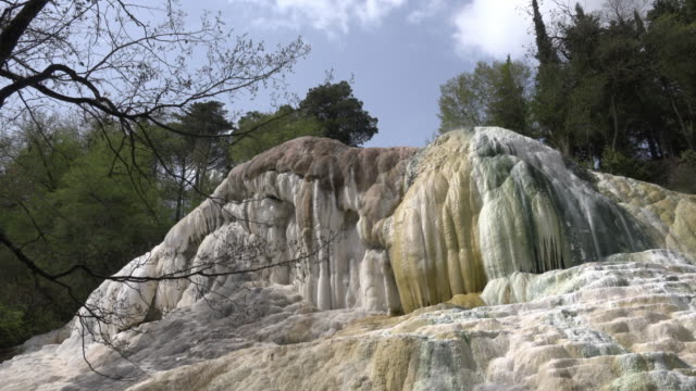 hot spring with white travertine rock - toscana video stock e b–roll