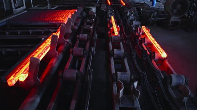 hot steel billets being stacked at a steel factory - foundry stock videos & royalty-free footage