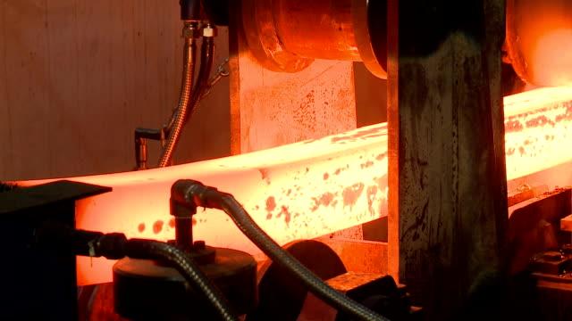 hot steel ingots on conveyor. foundry casting process, - ingot stock videos and b-roll footage