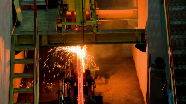 hot steel ingots on conveyor. foundry casting process, - metallurgy stock videos & royalty-free footage