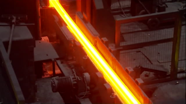 hot steel moving along conveyor belt in tata steel works in scunthorpe 2014 now known as british steel in relation to the story of british steel... - foundry stock videos & royalty-free footage