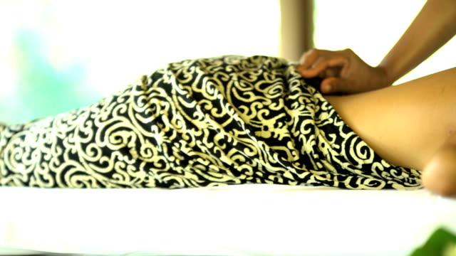 hot stone massage treatment by professional masseuse bali - spa treatment点の映像素材/bロール