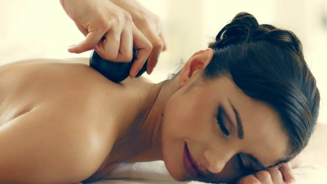 hot stone massage - lastone therapy stock videos and b-roll footage