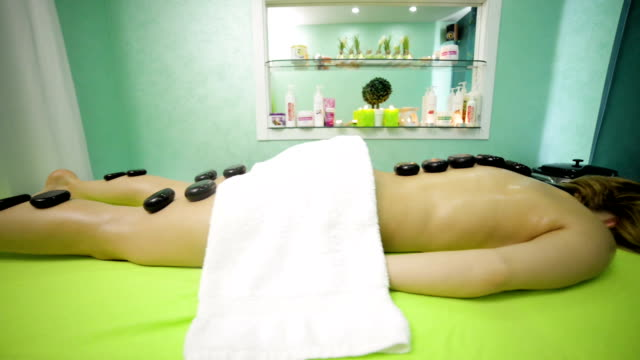 hot stone massage - massager stock videos and b-roll footage