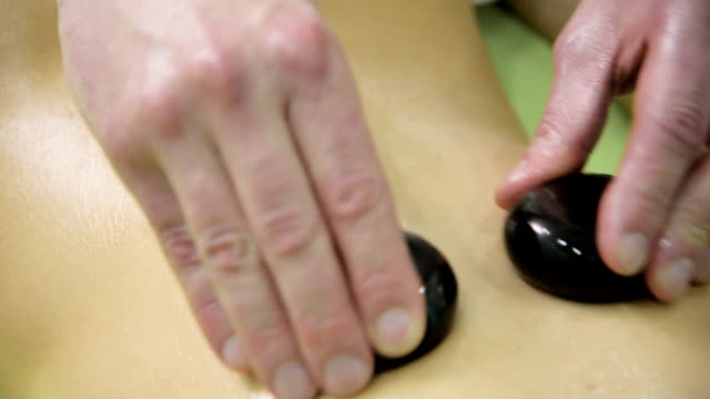 hot stone massage - lastone therapy stock videos & royalty-free footage