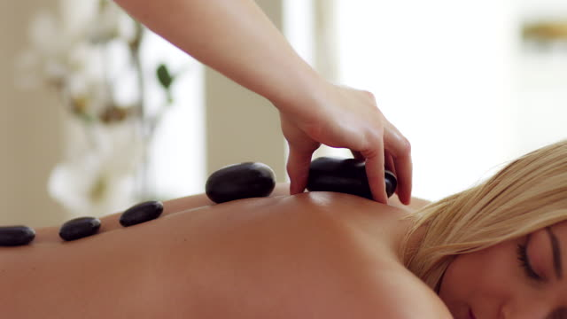 hot stone therapy - massage stock videos & royalty-free footage