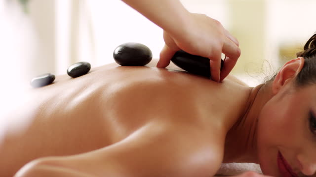 hot stone therapy - lastone therapy stock videos and b-roll footage