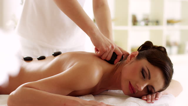 hot stone therapy - spa stock videos & royalty-free footage