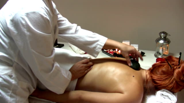hot stone treatment - lastone therapy stock videos & royalty-free footage