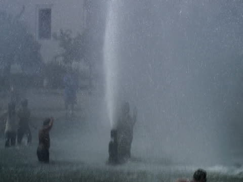 hot summer day; kids in fountain - squirting girl stock videos and b-roll footage